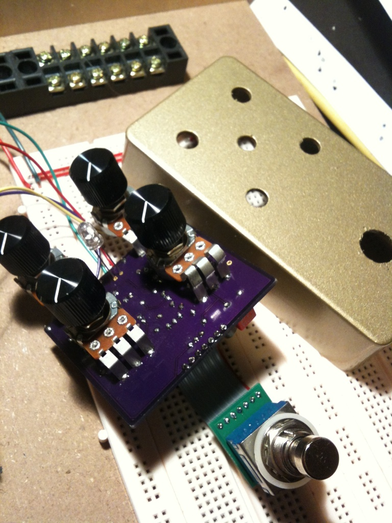 The ill-fated gold enclosure next to the assembled Fuzz circuit